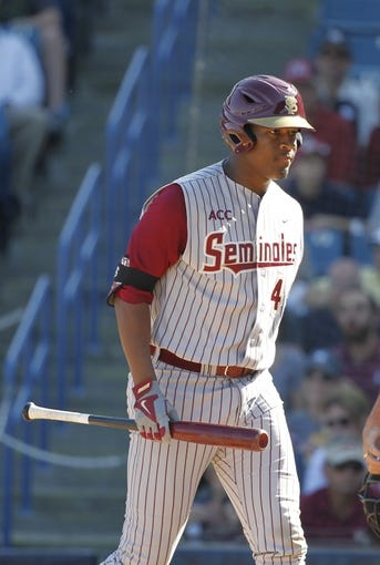 Feb 25, 2014; Tampa, FL, USA; Florida State Seminoles pitcher/outfielder Jameis Winston (44) walks back to the dugout after he struck out during the eighth inning against the New York Yankees at George M. Steinbrenner Field. Mandatory Credit: Kim Klement-USA TODAY Sports