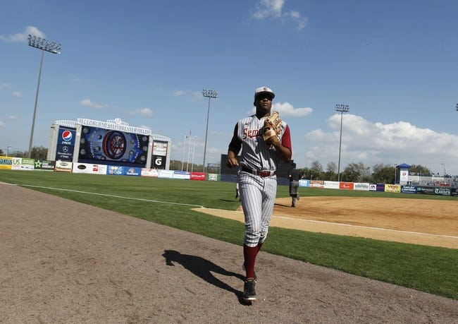 Feb 25, 2014; Tampa, FL, USA; Florida State Seminoles pitcher/outfielder Jameis Winston (44) runs back to the dugout during the sixth inning against the New York Yankees at George M. Steinbrenner Field. Mandatory Credit: Kim Klement-USA TODAY Sports