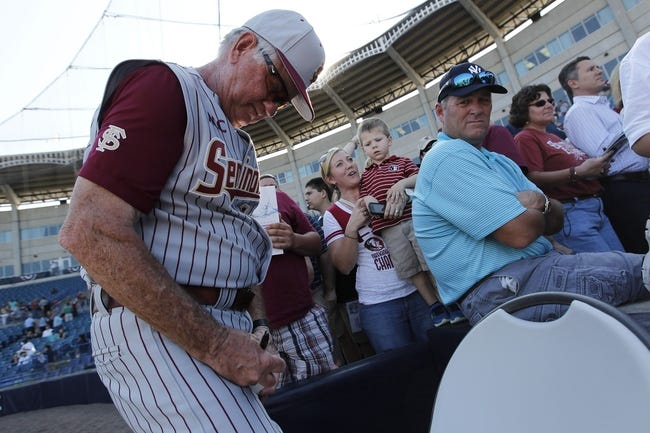 Feb 25, 2014; Tampa, FL, USA; Florida State Seminoles head coach Mike Martin (11) signs autographs after the game against the New York Yankees at George M. Steinbrenner Field. Mandatory Credit: Kim Klement-USA TODAY Sports