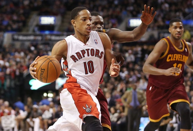 Feb 21, 2014; Toronto, Ontario, CAN; Toronto Raptors guard DeMar DeRozan (10) drives to the basket past Cleveland Cavaliers forward Luol Deng (9) at Air Canada Centre. The Raptors beat the Cavaliers 98-91. Mandatory Credit: Tom Szczerbowski-USA TODAY Sports