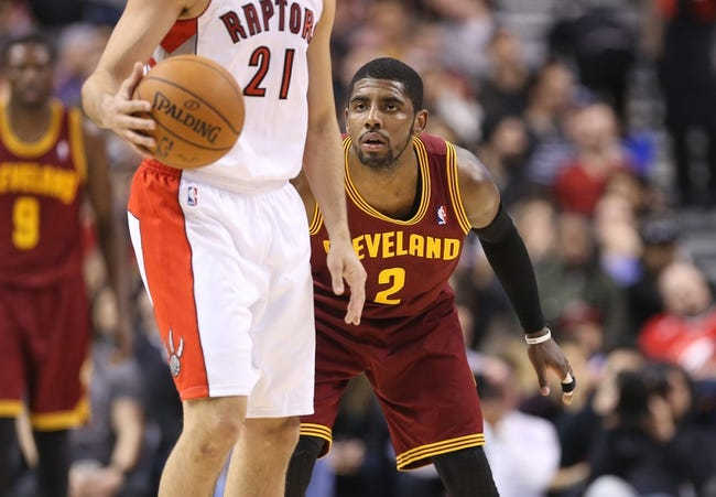 Feb 21, 2014; Toronto, Ontario, CAN; Cleveland Cavaliers guard Kyrie Irving (2) plays defense against Toronto Raptors guard Greivis Vasquez (21) at Air Canada Centre. The Raptors beat the Cavaliers 98-91. Mandatory Credit: Tom Szczerbowski-USA TODAY Sports
