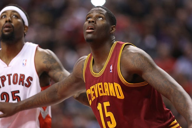 Feb 21, 2014; Toronto, Ontario, CAN; Cleveland Cavaliers forward Anthony Bennett (15) watches a free throw next to Toronto Raptors forward John Salmons (25) at Air Canada Centre. The Raptors beat the Cavaliers 98-91. Mandatory Credit: Tom Szczerbowski-USA TODAY Sports