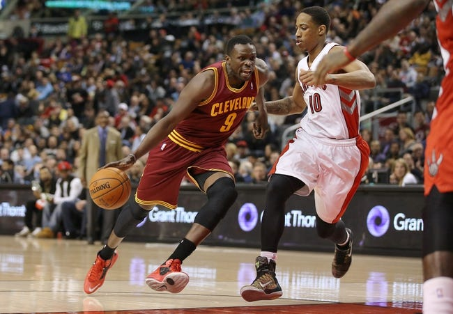 Feb 21, 2014; Toronto, Ontario, CAN; Cleveland Cavaliers forward Luol Deng (9) drives to the basket past Toronto Raptors guard DeMar DeRozan (10) at Air Canada Centre. The Raptors beat the Cavaliers 98-91. Mandatory Credit: Tom Szczerbowski-USA TODAY Sports