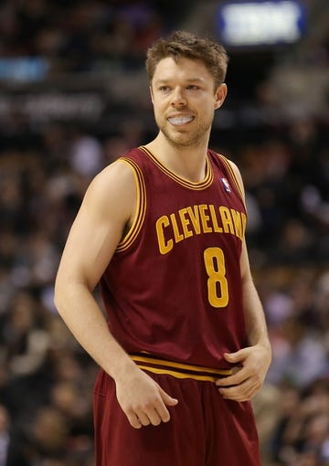 Feb 21, 2014; Toronto, Ontario, CAN; Cleveland Cavaliers guard Matthew Dellavedova (8) during the game against the Toronto Raptors at Air Canada Centre. The Raptors beat the Cavaliers 98-91. Mandatory Credit: Tom Szczerbowski-USA TODAY Sports