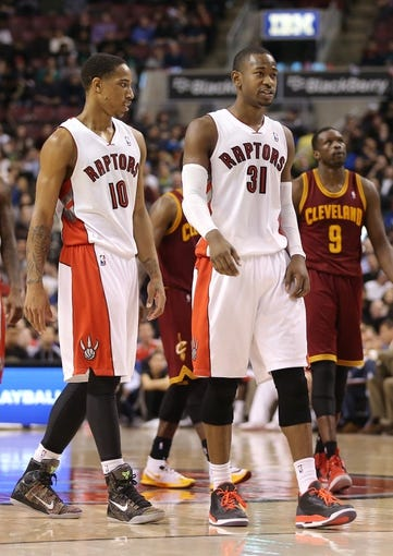 Feb 21, 2014; Toronto, Ontario, CAN; Toronto Raptors guard DeMar DeRozan (10) and guard Terrence Ross (31) during a break in the action against the Cleveland Cavaliers at Air Canada Centre. The Raptors beat the Cavaliers 98-91. Mandatory Credit: Tom Szczerbowski-USA TODAY Sports