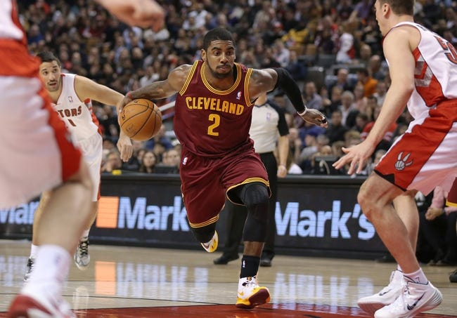 Feb 21, 2014; Toronto, Ontario, CAN; Cleveland Cavaliers guard Kyrie Irving (2) drives to the basket against the Toronto Raptors at Air Canada Centre. The Raptors beat the Cavaliers 98-91. Mandatory Credit: Tom Szczerbowski-USA TODAY Sports