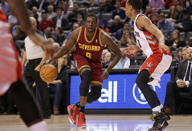 Feb 21, 2014; Toronto, Ontario, CAN; Cleveland Cavaliers forward Luol Deng (9) dribbles against the Toronto Raptors at Air Canada Centre. The Raptors beat the Cavaliers 98-91. Mandatory Credit: Tom Szczerbowski-USA TODAY Sports