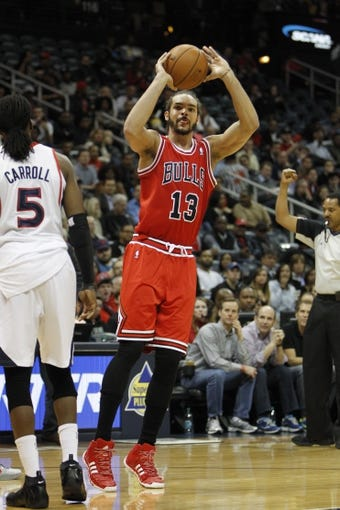 Feb 25, 2014; Atlanta, GA, USA; Chicago Bulls center Joakim Noah (13) shoots the ball against the Atlanta Hawks in the first quarter at Philips Arena. Mandatory Credit: Brett Davis-USA TODAY Sports
