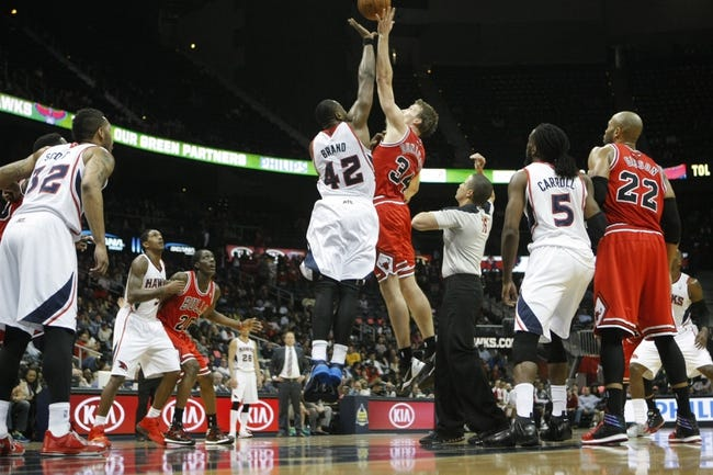 Feb 25, 2014; Atlanta, GA, USA; Atlanta Hawks power forward Elton Brand (42) and Chicago Bulls small forward Mike Dunleavy (34) compete for a jump ball in the second quarter at Philips Arena. Mandatory Credit: Brett Davis-USA TODAY Sports