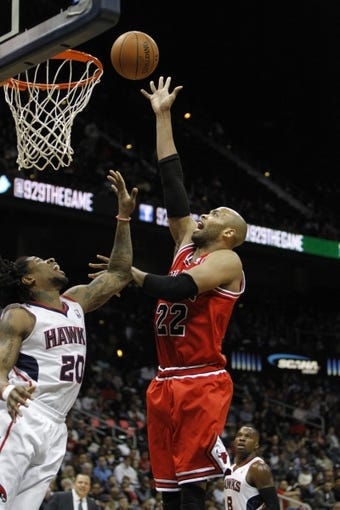 Feb 25, 2014; Atlanta, GA, USA; Chicago Bulls power forward Taj Gibson (22) shoots the ball against the Atlanta Hawks in the second quarter at Philips Arena. Mandatory Credit: Brett Davis-USA TODAY Sports