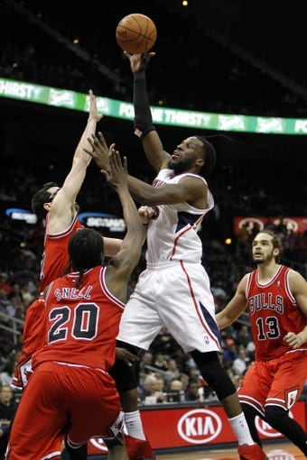 Feb 25, 2014; Atlanta, GA, USA; Atlanta Hawks small forward DeMarre Carroll (5) shoots the ball against the Chicago Bulls in the third quarter at Philips Arena. Mandatory Credit: Brett Davis-USA TODAY Sports
