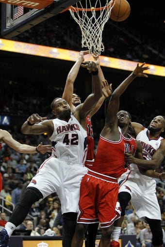 Feb 25, 2014; Atlanta, GA, USA; Atlanta Hawks power forward Elton Brand (42) and Chicago Bulls shooting guard Tony Snell (20) fight for a rebound in the third quarter at Philips Arena. Mandatory Credit: Brett Davis-USA TODAY Sports