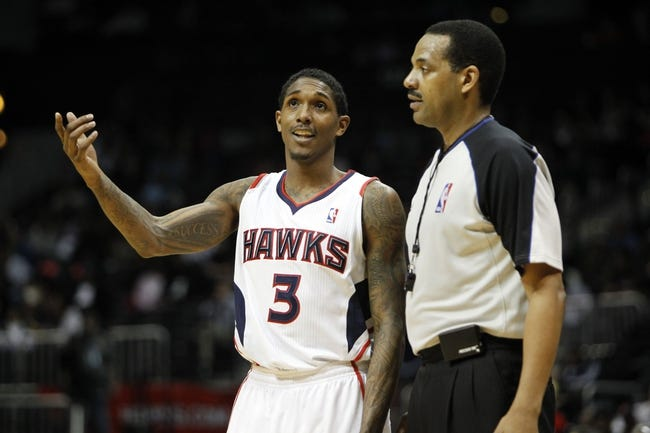 Feb 25, 2014; Atlanta, GA, USA; Atlanta Hawks shooting guard Louis Williams (3) talks to NBA referee  Bennie Adams (47) against the Chicago Bulls in the fourth quarter at Philips Arena. The Bulls defeated the Hawks 107-103. Mandatory Credit: Brett Davis-USA TODAY Sports