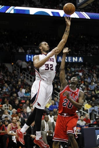 Feb 25, 2014; Atlanta, GA, USA; Atlanta Hawks power forward Mike Scott (32) shoots the ball against the Chicago Bulls in the third quarter at Philips Arena. Mandatory Credit: Brett Davis-USA TODAY Sports