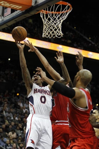 Feb 25, 2014; Atlanta, GA, USA; Atlanta Hawks point guard Jeff Teague (0) shoots the ball against the Chicago Bulls in the fourth quarter at Philips Arena. The Bulls defeated the Hawks 107-103. Mandatory Credit: Brett Davis-USA TODAY Sports