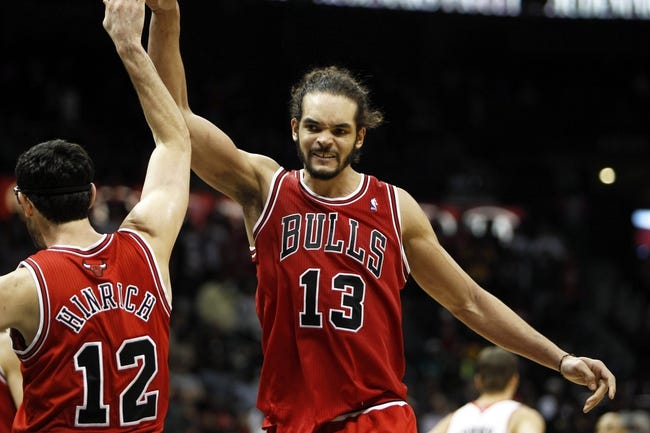Feb 25, 2014; Atlanta, GA, USA; Chicago Bulls center Joakim Noah (13) celebrates with shooting guard Kirk Hinrich (12) against the Atlanta Hawks in the fourth quarter at Philips Arena. The Bulls defeated the Hawks 107-103. Mandatory Credit: Brett Davis-USA TODAY Sports