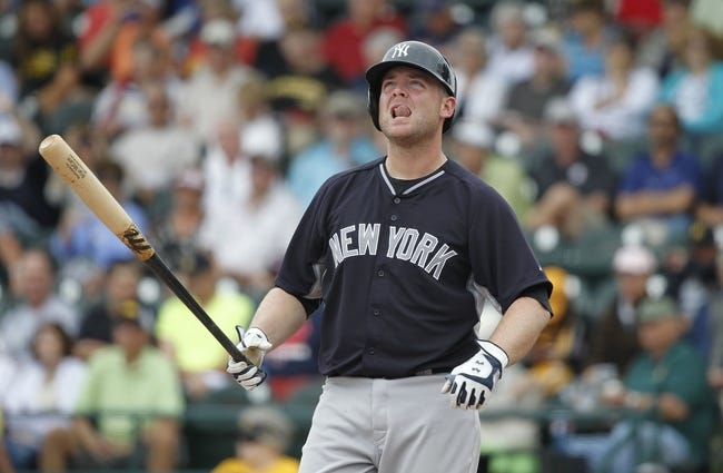 Feb 26, 2014; Bradenton, FL, USA; New York Yankees catcher Brian McCann (34) looks up while at bat during the third inning against the Pittsburgh Pirates at McKechnie Field. Mandatory Credit: Kim Klement-USA TODAY Sports