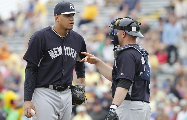 Feb 26, 2014; Bradenton, FL, USA; New York Yankees relief pitcher Dellin Betances (68) talks with catcher Brian McCann (34) before he pitches during the fourth inning against the Pittsburgh Pirates at McKechnie Field. Mandatory Credit: Kim Klement-USA TODAY Sports