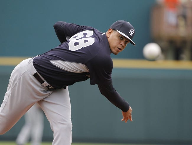 Feb 26, 2014; Bradenton, FL, USA; New York Yankees relief pitcher Dellin Betances (68) throws a pitch as he warms up during the fourth inning against the Pittsburgh Pirates at McKechnie Field. Mandatory Credit: Kim Klement-USA TODAY Sports