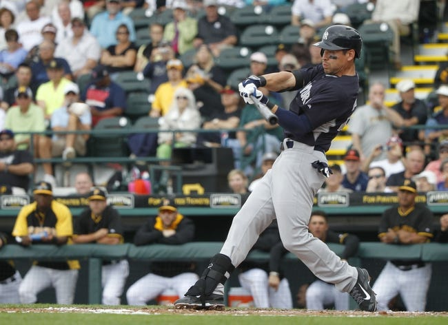 Feb 26, 2014; Bradenton, FL, USA; New York Yankees center fielder Jacoby Ellsbury (22) singles during the fifth inning against the Pittsburgh Pirates at McKechnie Field. Mandatory Credit: Kim Klement-USA TODAY Sports