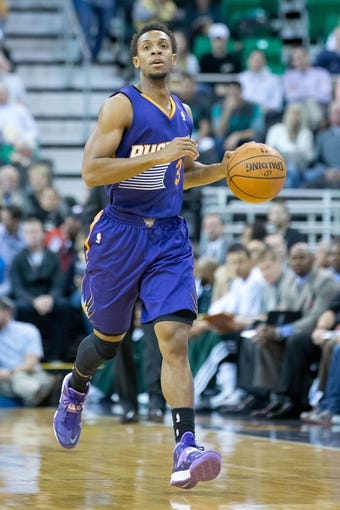 Feb 26, 2014; Salt Lake City, UT, USA; Phoenix Suns point guard Ish Smith (3) moves up the court during the first half against the Utah Jazz at EnergySolutions Arena. Mandatory Credit: Russ Isabella-USA TODAY Sports