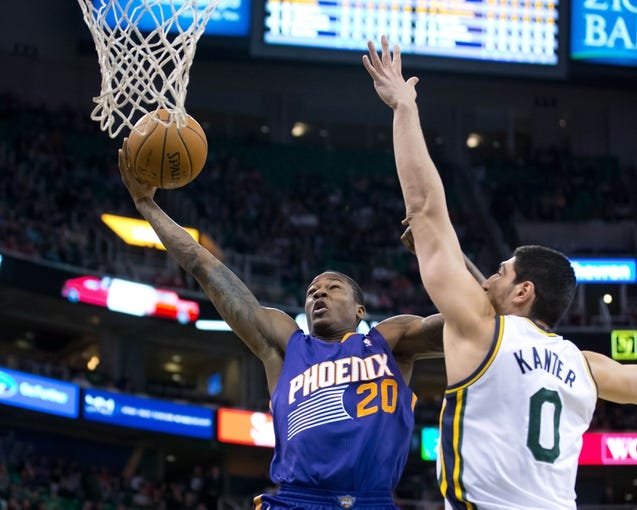 Feb 26, 2014; Salt Lake City, UT, USA; Phoenix Suns shooting guard Archie Goodwin (20) goes to the basket while defended by Utah Jazz center Enes Kanter (0) during the first half at EnergySolutions Arena. Mandatory Credit: Russ Isabella-USA TODAY Sports