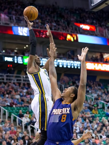 Feb 26, 2014; Salt Lake City, UT, USA; Utah Jazz small forward Jeremy Evans (40) shoots over Phoenix Suns power forward Channing Frye (8) during the second half at EnergySolutions Arena. The Jazz won 109-86. Mandatory Credit: Russ Isabella-USA TODAY Sports