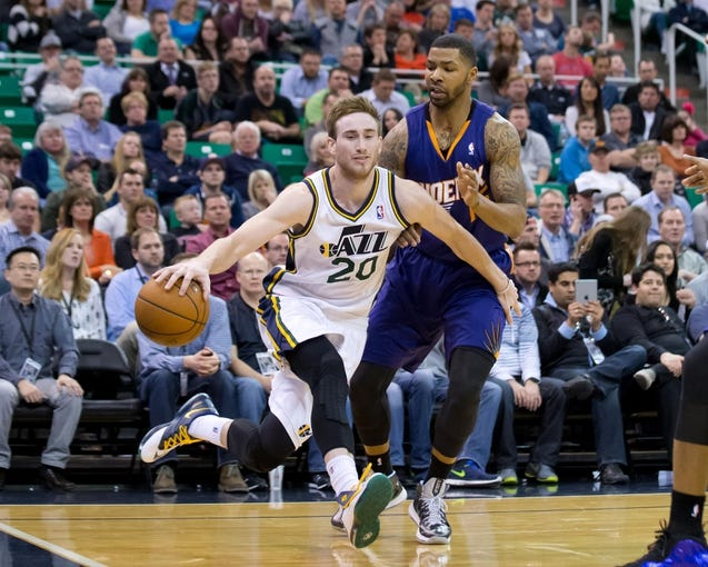 Feb 26, 2014; Salt Lake City, UT, USA; Utah Jazz shooting guard Gordon Hayward (20) is fouled by Phoenix Suns power forward Marcus Morris (15) during the second half at EnergySolutions Arena. The Jazz won 109-86. Mandatory Credit: Russ Isabella-USA TODAY Sports