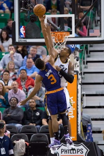 Feb 26, 2014; Salt Lake City, UT, USA; Utah Jazz center Derrick Favors (15) blocks the shot of Phoenix Suns point guard Ish Smith (3) during the second half at EnergySolutions Arena. The Jazz won 109-86. Mandatory Credit: Russ Isabella-USA TODAY Sports