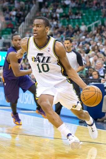 Feb 26, 2014; Salt Lake City, UT, USA; Utah Jazz point guard Alec Burks (10) dribbles the ball during the second half against the Phoenix Suns at EnergySolutions Arena. The Jazz won 109-86. Mandatory Credit: Russ Isabella-USA TODAY Sports