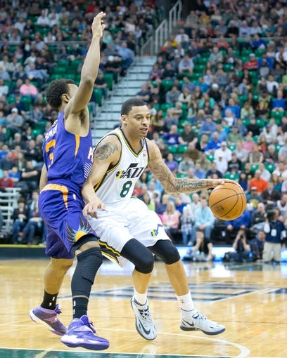 Feb 26, 2014; Salt Lake City, UT, USA; Phoenix Suns point guard Ish Smith (3) defends against Utah Jazz point guard Diante Garrett (8) during the second half at EnergySolutions Arena. The Jazz won 109-86. Mandatory Credit: Russ Isabella-USA TODAY Sports