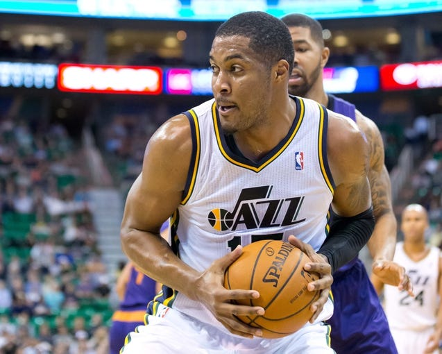 Feb 26, 2014; Salt Lake City, UT, USA; Utah Jazz center Derrick Favors (15) controls the ball during the second half against the Phoenix Suns at EnergySolutions Arena. The Jazz won 109-86. Mandatory Credit: Russ Isabella-USA TODAY Sports