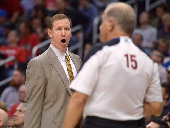 Feb 12, 2014; Los Angeles, CA, USA; Portland Trail Blazers coach Terry Stotts gestures toward referee Bennett Salvatore (15) during the game against the Los Angeles Clippers at Staples Center. Mandatory Credit: Kirby Lee-USA TODAY Sports