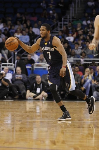 Feb 12, 2014; Orlando, FL, USA; Memphis Grizzlies point guard Darius Morris (7) dribbles the ball against the Orlando Magic during the second quarter at Amway Center. Mandatory Credit: Kim Klement-USA TODAY Sports