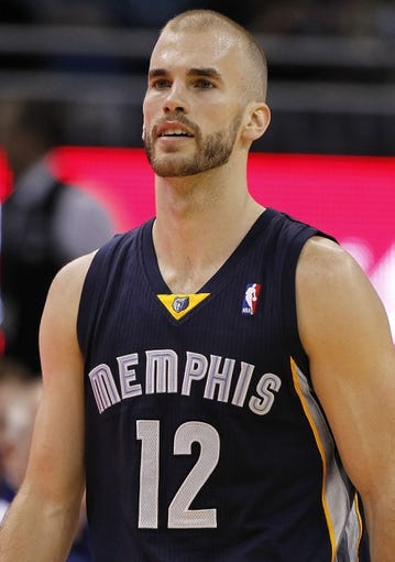 Feb 12, 2014; Orlando, FL, USA; Memphis Grizzlies shooting guard Nick Calathes (12) against the Orlando Magic during the second quarter at Amway Center. Mandatory Credit: Kim Klement-USA TODAY Sports