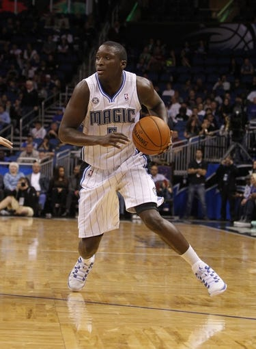 Feb 12, 2014; Orlando, FL, USA; Orlando Magic shooting guard Victor Oladipo (5) drives to the basket against the Memphis Grizzlies during the second half at Amway Center. Memphis Grizzlies defeated the Orlando Magic 86-81. Mandatory Credit: Kim Klement-USA TODAY Sports
