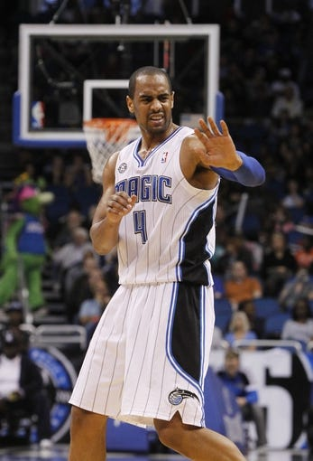 Feb 12, 2014; Orlando, FL, USA; Orlando Magic shooting guard Arron Afflalo (4) reacts against the Memphis Grizzlies during the second half at Amway Center. Memphis Grizzlies defeated the Orlando Magic 86-81. Mandatory Credit: Kim Klement-USA TODAY Sports