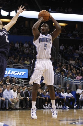 Feb 12, 2014; Orlando, FL, USA; Orlando Magic shooting guard Victor Oladipo (5) shoots against the Memphis Grizzlies during the second half at Amway Center. Memphis Grizzlies defeated the Orlando Magic 86-81. Mandatory Credit: Kim Klement-USA TODAY Sports