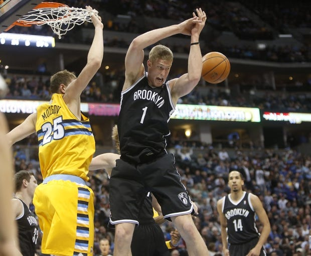 Feb 27, 2014; Denver, CO, USA; Brooklyn Nets center Mason Plumlee (1) looses control of the ball attempting a rebound during the first half against the Denver Nuggets at Pepsi Center. Mandatory Credit: Chris Humphreys-USA TODAY Sports