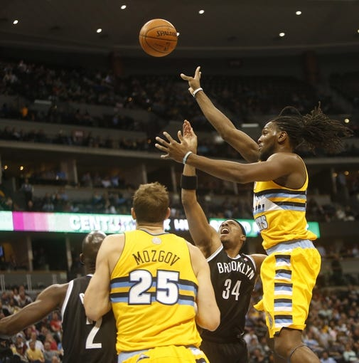 Feb 27, 2014; Denver, CO, USA; Denver Nuggets forward Kenneth Faried (35) shoots the ball during the first half against the Brooklyn Nets at Pepsi Center. Mandatory Credit: Chris Humphreys-USA TODAY Sports