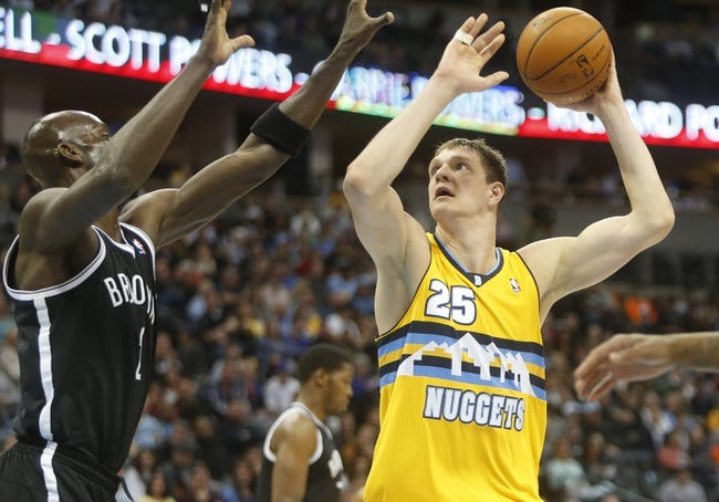 Feb 27, 2014; Denver, CO, USA; Denver Nuggets center Timofey Mozgov (25) shoots the ball during the first half against the Brooklyn Nets at Pepsi Center. Mandatory Credit: Chris Humphreys-USA TODAY Sports