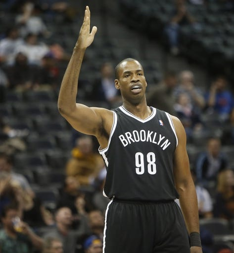Feb 27, 2014; Denver, CO, USA; Brooklyn Nets center Jason Collins (98) during the second half against the Denver Nuggets at Pepsi Center.  The Nets won 112-89.  Mandatory Credit: Chris Humphreys-USA TODAY Sports