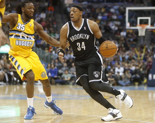 Feb 27, 2014; Denver, CO, USA; Brooklyn Nets forward Paul Pierce (34) drives to the basket against Denver Nuggets forward Kenneth Faried (35) during the second half at Pepsi Center.  The Nets won 112-89.  Mandatory Credit: Chris Humphreys-USA TODAY Sports
