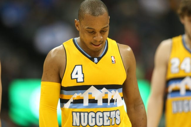 Feb 27, 2014; Denver, CO, USA; Denver Nuggets guard Randy Foye (4) reacts during the second half against the Brooklyn Nets at Pepsi Center.  The Nets won 112-89.  Mandatory Credit: Chris Humphreys-USA TODAY Sports