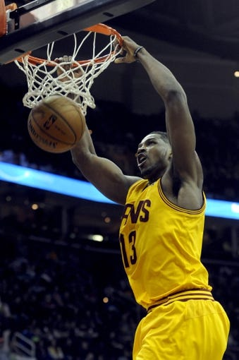 Feb 28, 2014; Cleveland, OH, USA; Cleveland Cavaliers power forward Tristan Thompson (13) dunks during the first quarter against the Utah Jazz at Quicken Loans Arena. Mandatory Credit: Ken Blaze-USA TODAY Sports