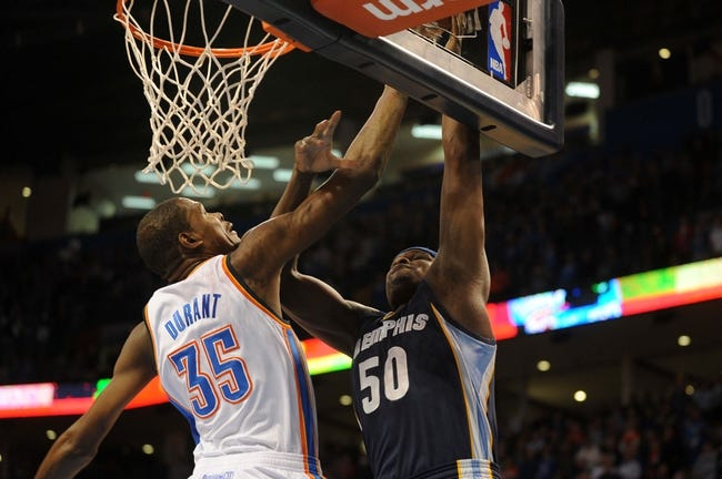Feb 28, 2014; Oklahoma City, OK, USA; Memphis Grizzlies power forward Zach Randolph (50) attempts a dunk against Oklahoma City Thunder small forward Kevin Durant (35) during the first quarter at Chesapeake Energy Arena. Mandatory Credit: Mark D. Smith-USA TODAY Sports
