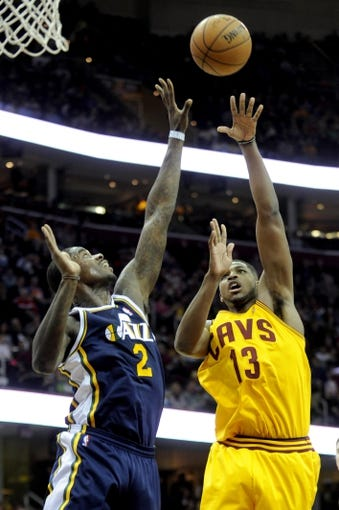 Feb 28, 2014; Cleveland, OH, USA; Cleveland Cavaliers power forward Tristan Thompson (13) shoots over Utah Jazz power forward Marvin Williams (2) during the second quarter at Quicken Loans Arena. Mandatory Credit: Ken Blaze-USA TODAY Sports