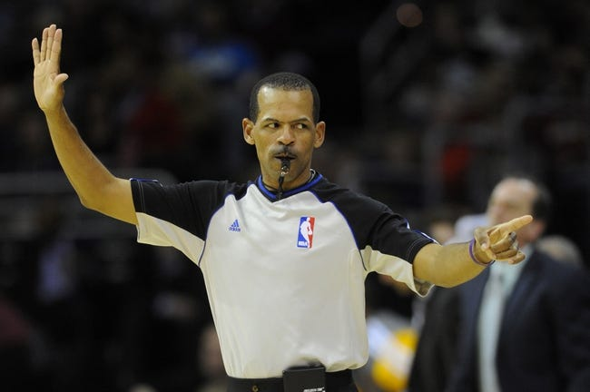 Feb 28, 2014; Cleveland, OH, USA; Referee Eric Lewis (42) makes a call during the second quarter between the Cleveland Cavaliers and the Utah Jazz at Quicken Loans Arena. Mandatory Credit: Ken Blaze-USA TODAY Sports