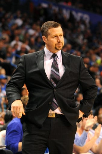 Feb 28, 2014; Oklahoma City, OK, USA; Memphis Grizzlies head coach David Joerger reacts to a play in action against the Oklahoma City Thunder at Chesapeake Energy Arena. Mandatory Credit: Mark D. Smith-USA TODAY Sports