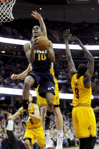 Feb 28, 2014; Cleveland, OH, USA; Utah Jazz point guard Alec Burks (10) drives to the basket during the fourth quarter against the Cleveland Cavaliers at Quicken Loans Arena. The Cavaliers beat the Jazz 99-79. Mandatory Credit: Ken Blaze-USA TODAY Sports